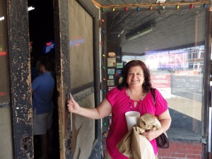 My sister Cheryl opening the screen door at Louie Mueller