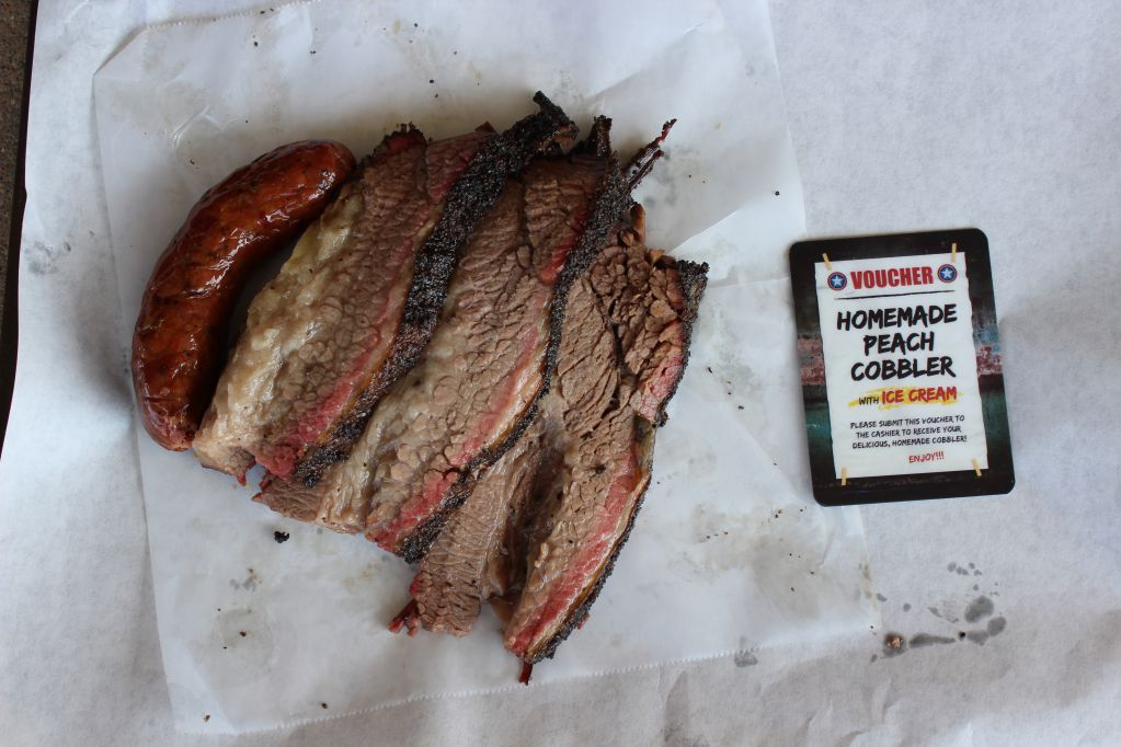 Brisket, Chipotle Sausage, and the voucher for peach cobbler