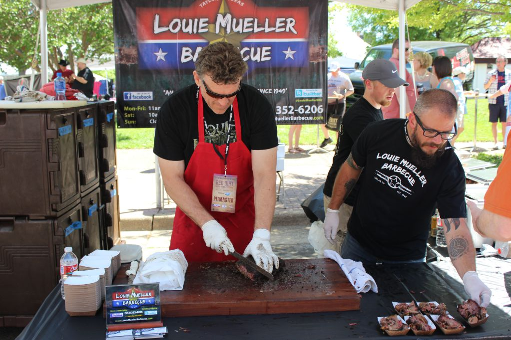 Wayne Mueller slicing brisket for fans at Red Dirt BBQ Fest