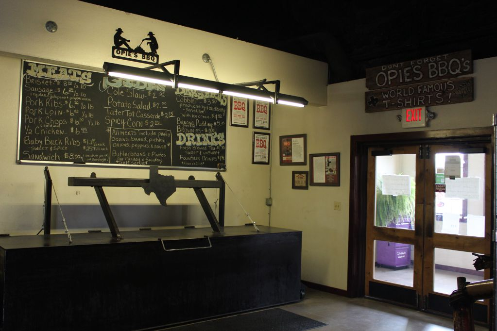 menu and warming pit at Opie's BBQ