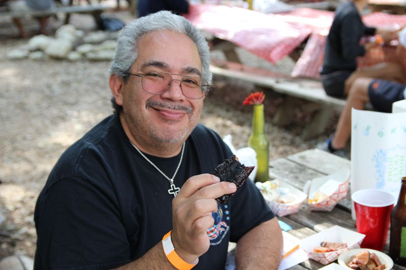 Ernest Ojeda shows off a burnt end from Black's Barbecue