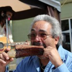Ernest Ojeda chomps on a beef rib