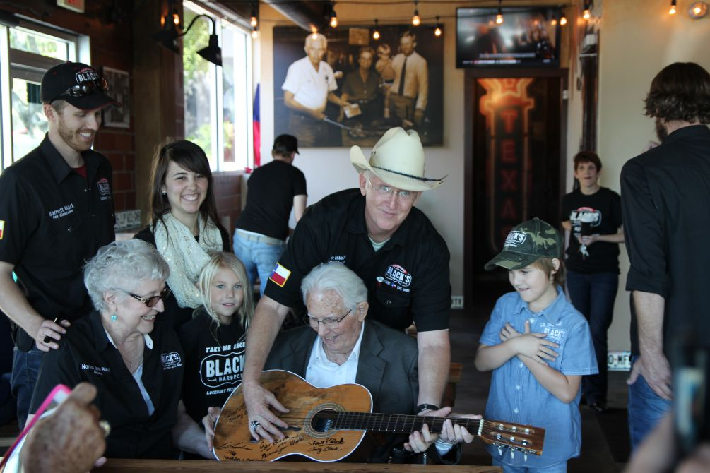 A replica of Willie Nelson's guitar Trigger was signed by the family