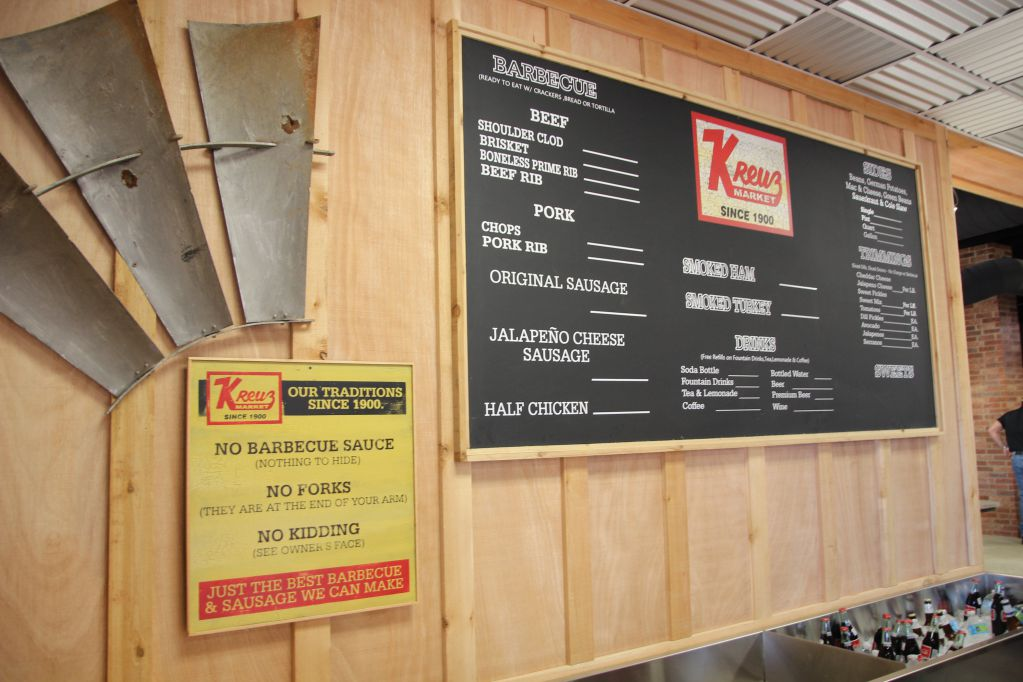 Familiar signage graces the wall at Kreuz Market in Bryan, Texas