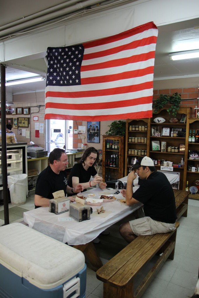 Scott, Joel, and Andrew discussing the meats at Vincek's Smokehouse