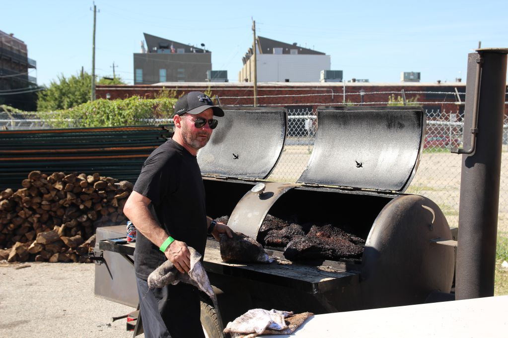 John Mueller pulling fresh brisket off the pit