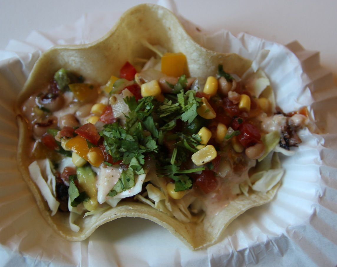 Corkscrew BBQ's brisket taco with Texas caviar and green chili sauce