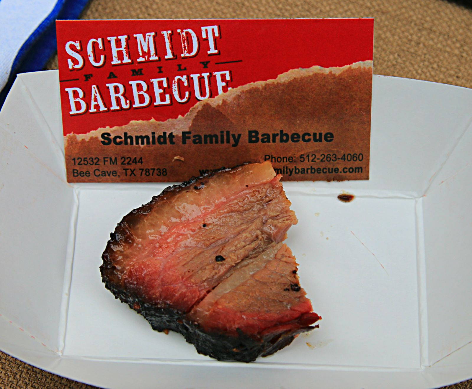 Schmidt Family Barbecue brisket (with a bite already taken) at Smoked Dallas 2016
