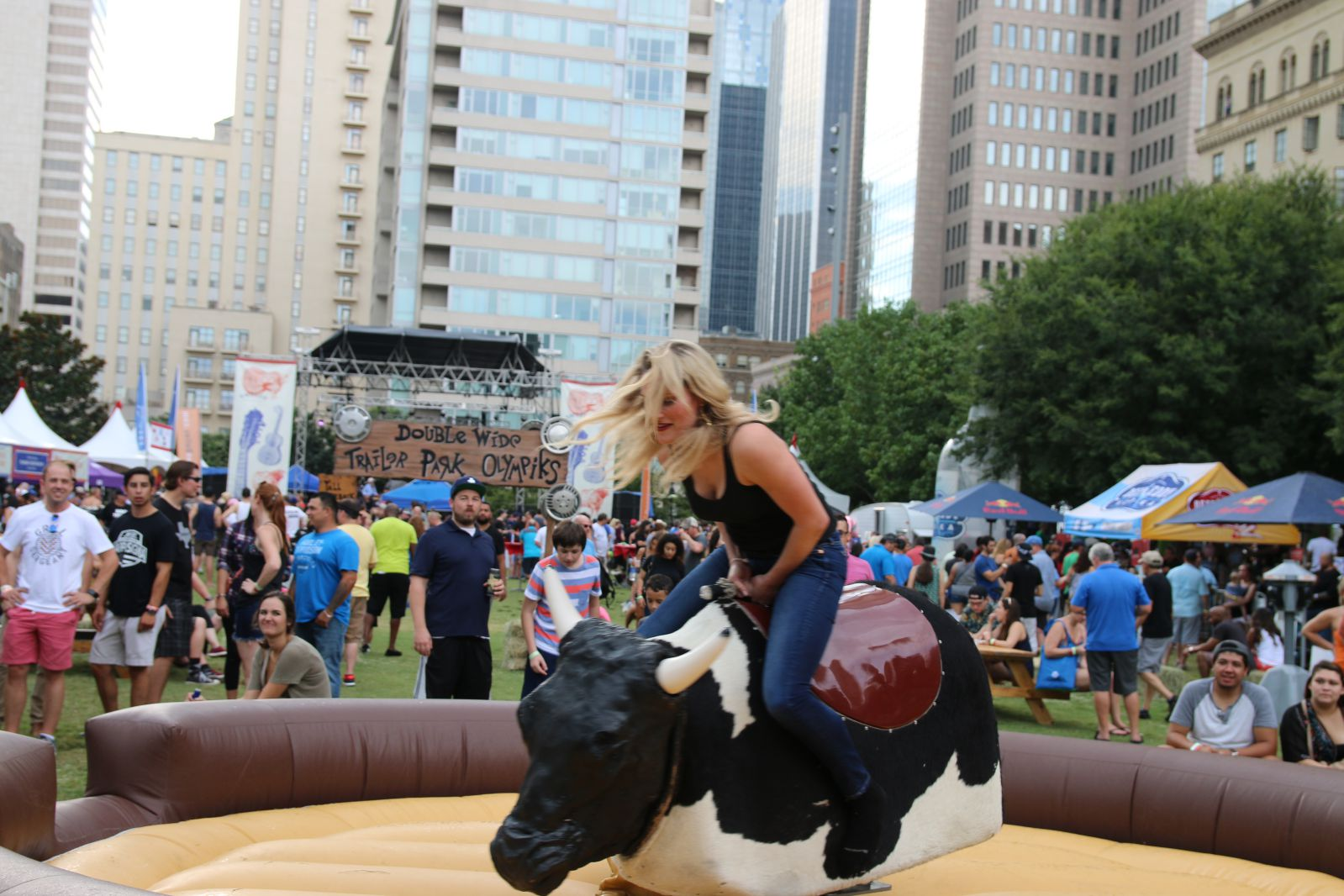 Mechanical bull as part of the Trailer Park Olympics at Smoked Dallas 2016