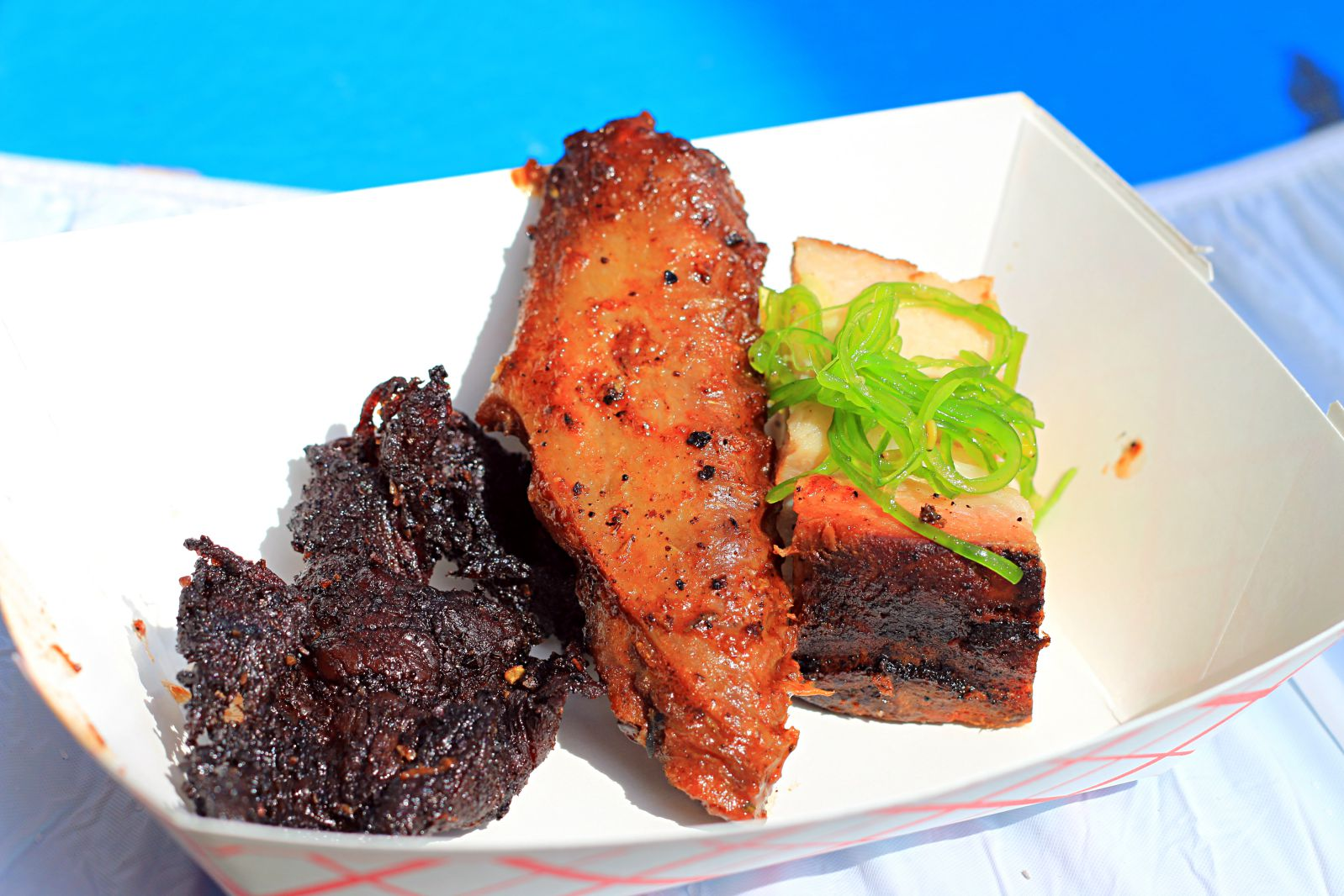 Harlem Road Texas BBQ burnt end, duck wing, and pork belly topped with pickled seaweed at The Woodlands BBQ Fest 2016