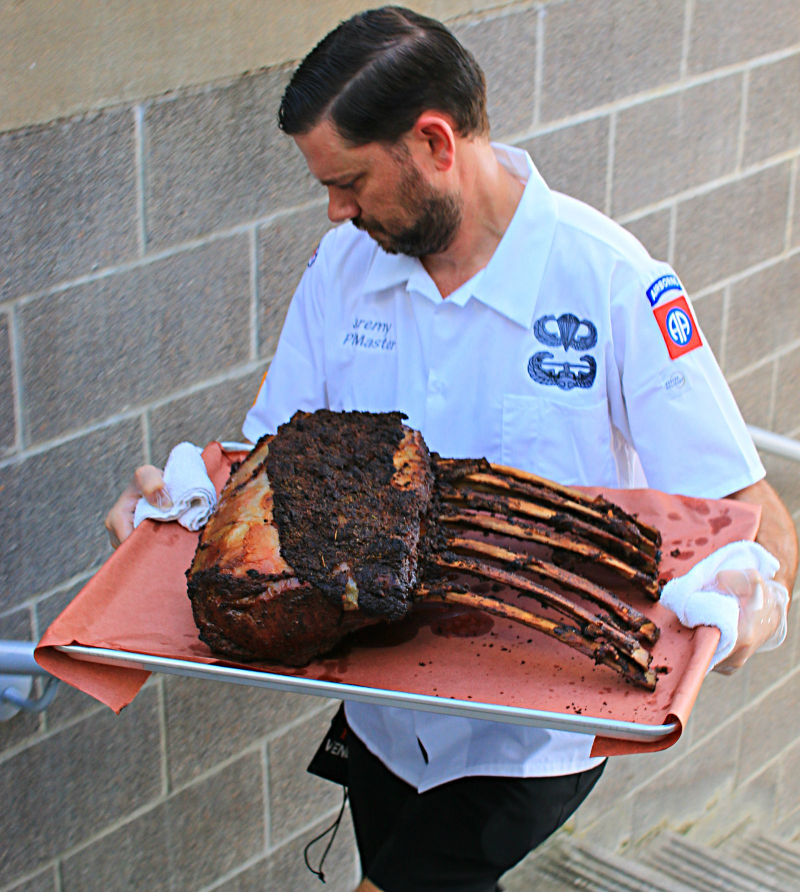 Bone-in prime rib headed to the Lockhart Smokehouse booth at Texas Monthly BBQ Fest 2016
