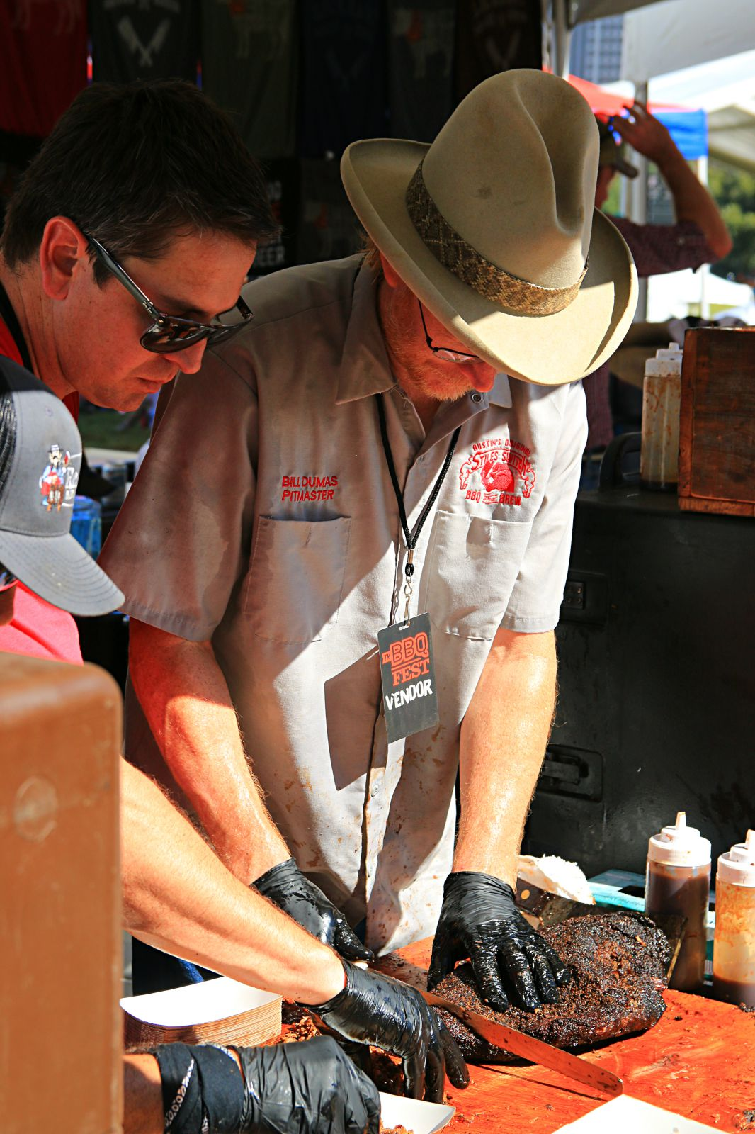 Bill Dumas slicing brisket for Stiles Switch at Texas Monthly BBQ Fest 2016