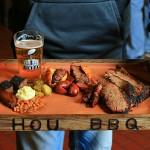 Samples from Harlem Road BBQ, Louie Mueller Barbecue, and Pinkerton's Barbecue grace Corey Taylor's tray at Super Beef 2017